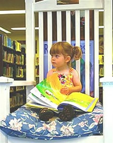 child readin in chair